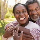 Happy African American Mature Couple at the park